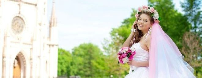 Beautiful young bride in a wreath of flowers on her head